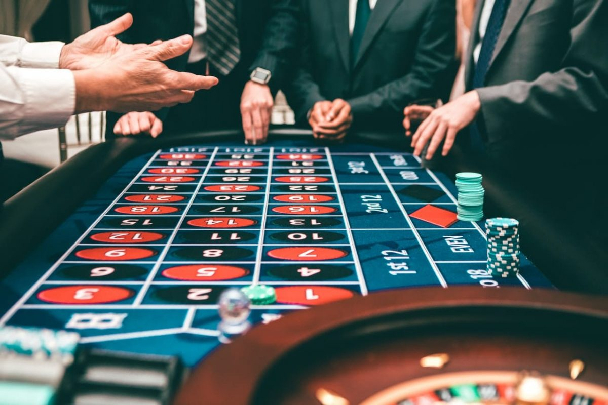 men playing roulette in casino